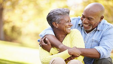 Older couple laughing after Glaucoma treatment