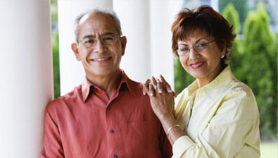 Older couple smiling after Cornea Treatment
